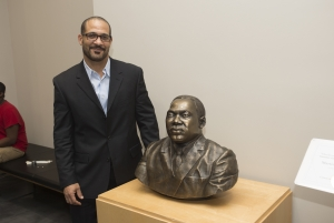 KSU professor Keith Smith stands alongside the bronze bust he created of Dr. Martin Luther King Jr.