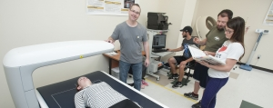 John McLester and students operate a DEXA machine
