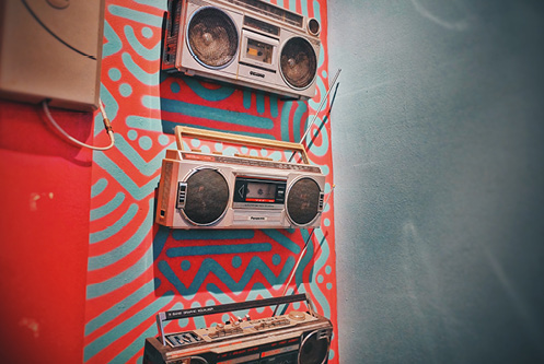 Boomboxes on a colorful wall