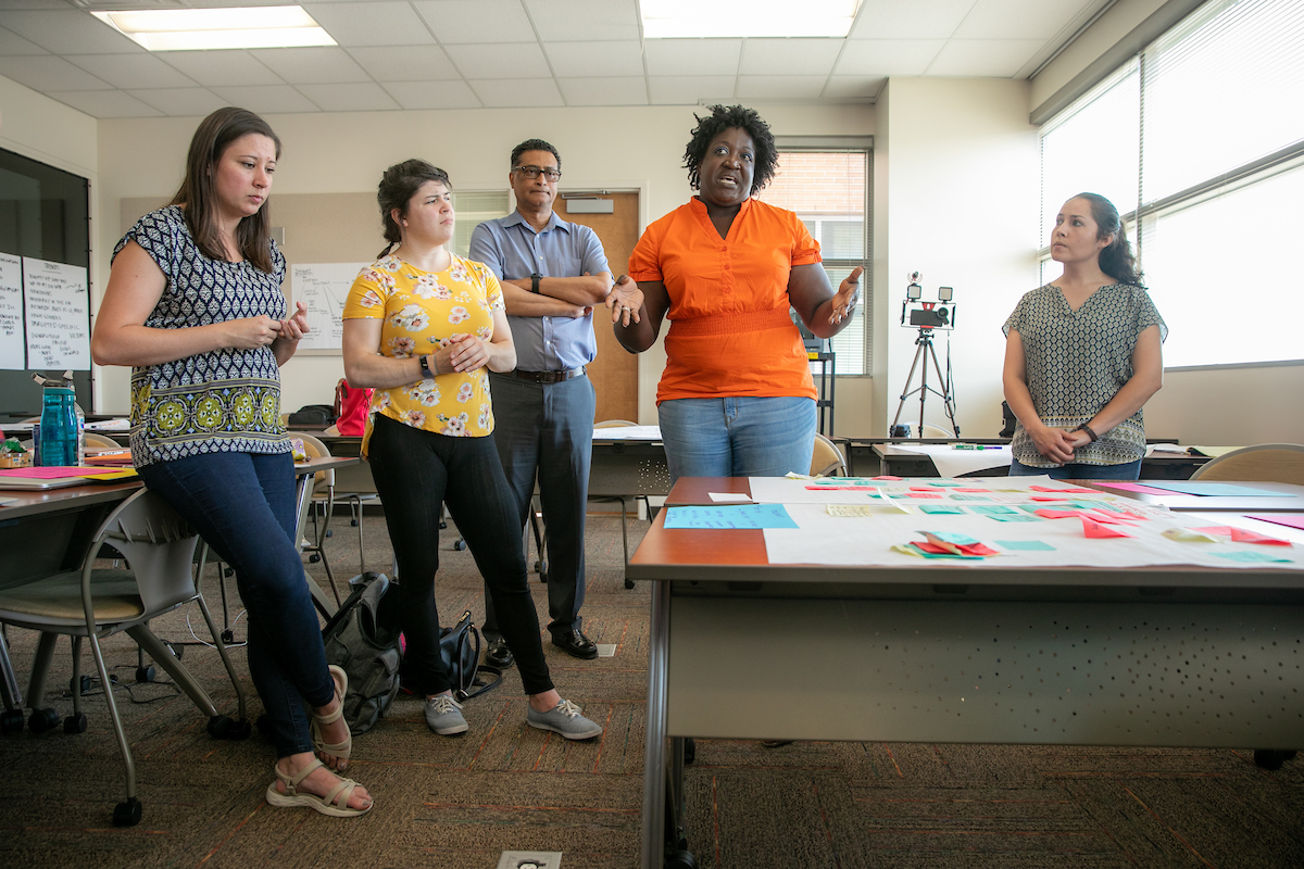 Graduate students present of a grantor about a project in the area of community mental health