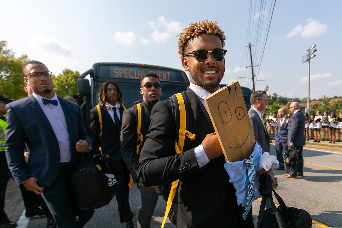 Kennesaw State University senior wide receiver Tanner Jones walks with Turnover Plank during Owl Walk before their game against Reinhardt Saturday, September 28, 2019